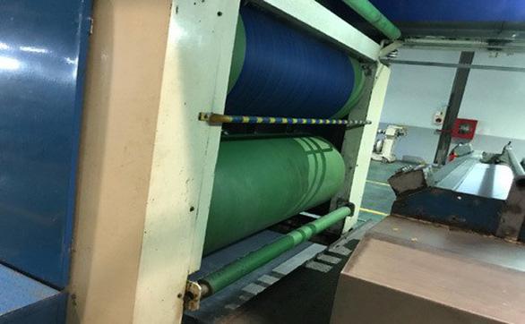 Phủ chống dính Teflon trục rulo trong ngành dệt - Ảnh 1.