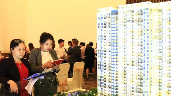Kiến nghị TP.HCM giải quyết 100 dự án bất động sản đóng băng - Ảnh 1.