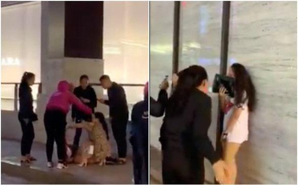 Xác định 4 người đánh ghen, lột đồ cô gái trẻ giữa phố Hà Nội - Ảnh 1.