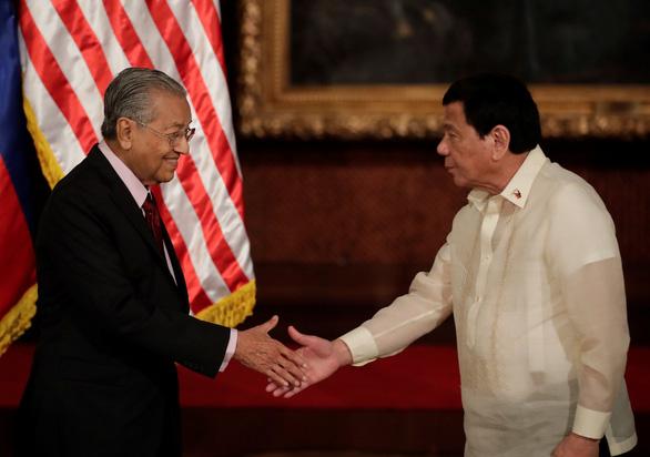 Malaysia, Philippines cam kết bảo đảm tự do đi lại trên Biển Đông - Ảnh 1.