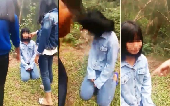Đuổi học một tuần 4 nữ sinh đánh, bắt quỳ nữ sinh lớp 7 - Ảnh 1.