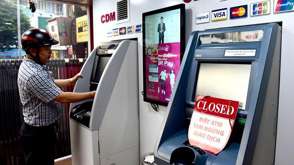 ATM nơi nghỉ lễ sớm, nơi giao dịch bất thành vẫn bị trừ tiền - Ảnh 1.