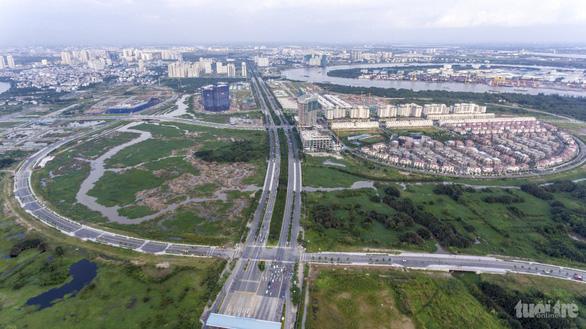TP.HCM giao Đại Quang Minh tự bỏ tiền làm hạ tầng 3 lô đất ở Thủ Thiêm - Ảnh 1.