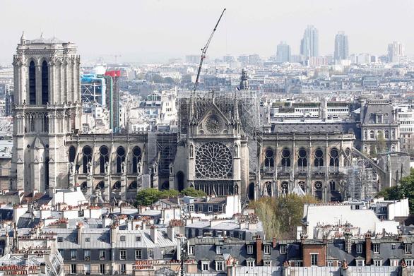 Tranh luận nảy lửa thời gian tái thiết nhà thờ Đức Bà Paris - Ảnh 1.