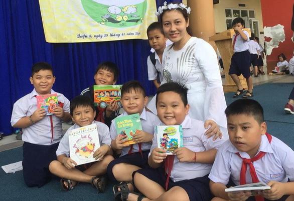 Mỗi gia đình, nhà trường cần xây dựng môi trường cho trẻ đọc sách - Ảnh 1.
