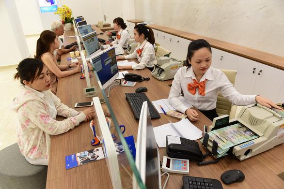 Nhiều ngân hàng 'sạch' nợ xấu tại VAMC - Ảnh 1.