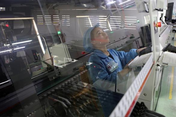 Trung Quốc công bố số liệu kinh tế lạc quan để đàm phán với Mỹ - Ảnh 1.