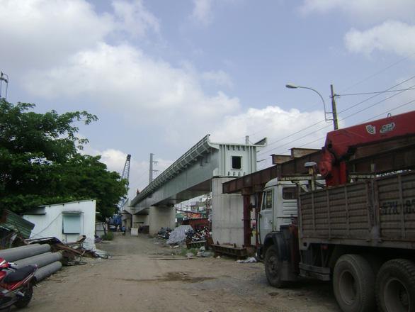 Lắp nhịp cầu Bình Lợi có khoang thông thuyền rộng 101m do Việt Nam thiết kế - Ảnh 4.