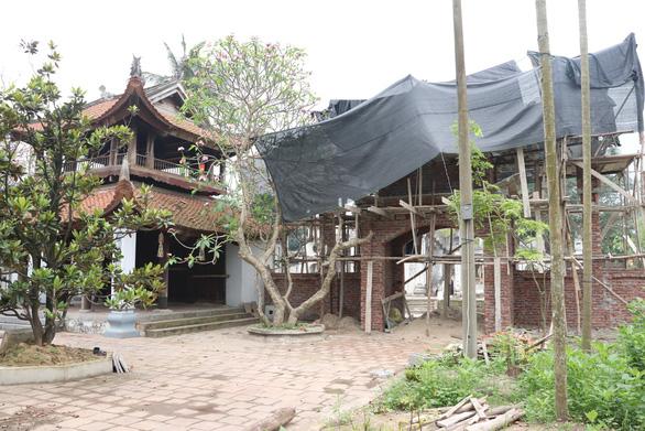 Phạt sư trụ trì chùa 20 triệu đồng vì xây dựng xâm phạm di tích - Ảnh 1.