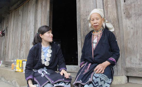 Cô gái người Dao làm du lịch cộng đồng - Ảnh 1.