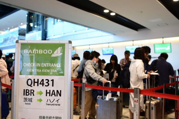 Bamboo Airways đưa những vị khách đầu tiên đến Nhật Bản - Ảnh 1.