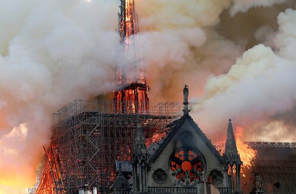 Pháp cảnh báo lượng bụi chì cực cao quanh nhà thờ Đức Bà Paris - Ảnh 1.