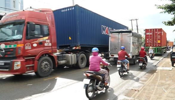 Khẩn trương mở rộng cung đường tử thần Nguyễn Duy Trinh - Ảnh 1.