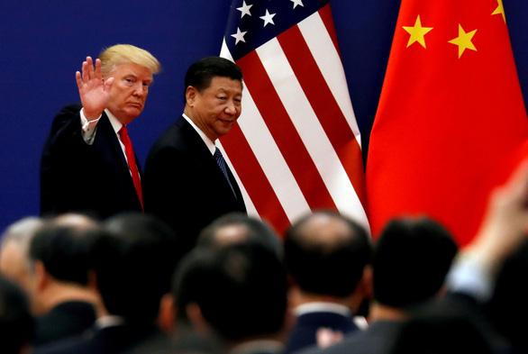 Ông Trump kêu gọi FED hạ lãi suất để so găng với Trung Quốc - Ảnh 2.