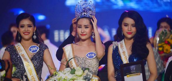 Ì xèo chưa rơi vào quên lãng, Hoa hậu Đại dương Việt bơi qua Mỹ - Ảnh 1.