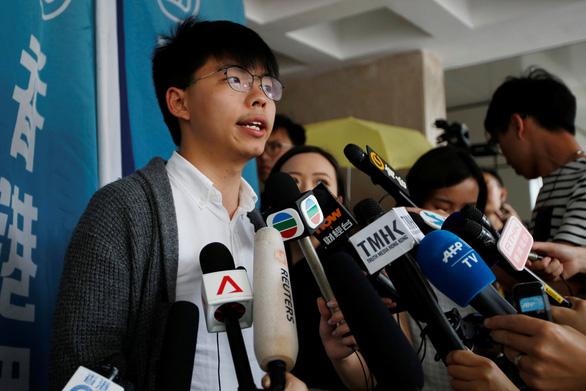 Thủ lĩnh sinh viên Hoàng Chi Phong lại bị bắt vào tù - Ảnh 1.