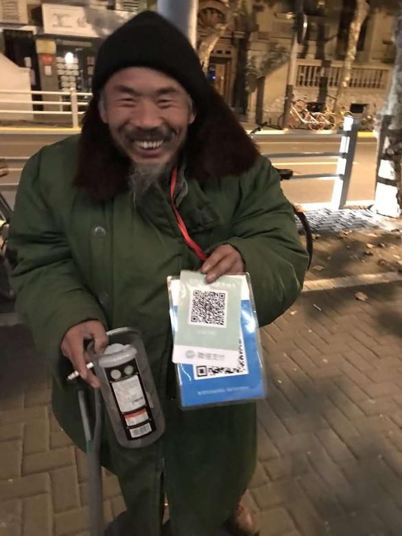 Cúng dường bằng ví điện tử, ăn xin nhận tiền qua QR Code - Ảnh 2.