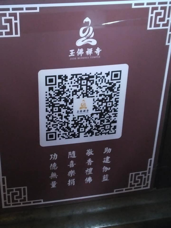 Cúng dường bằng ví điện tử, ăn xin nhận tiền qua QR Code - Ảnh 1.