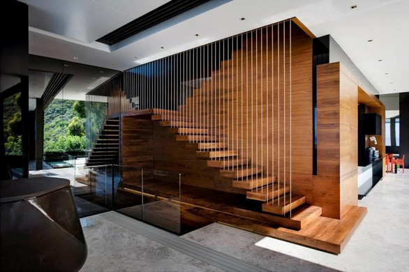 Có nên lát cầu thang bằng gỗ công nghiệp? - Ảnh 1.