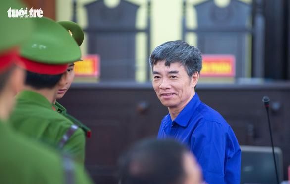 Bồi thường sai, hàng loạt cựu cán bộ tỉnh Sơn La hầu tòa - Ảnh 1.