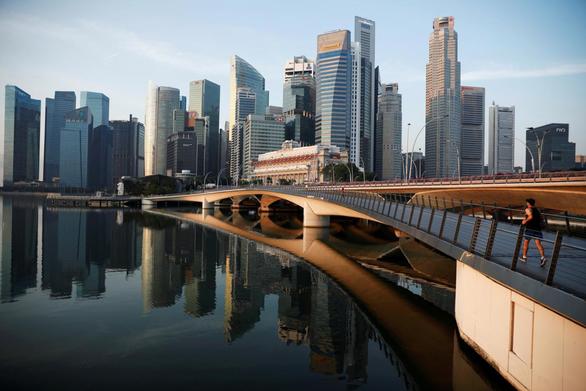 Thương chiến Mỹ - Trung: Singapore thiệt, Việt Nam lợi? - Ảnh 1.