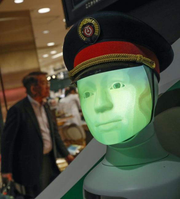 Nhật đưa robot hướng dẫn khách ở ga Tokyo - Ảnh 4.