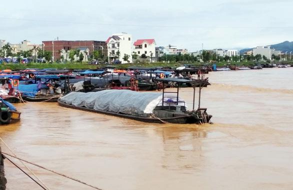 Trung Quốc bất ngờ xả lũ gây lũ trên sông Ka Long, một người mất tích - Ảnh 1.