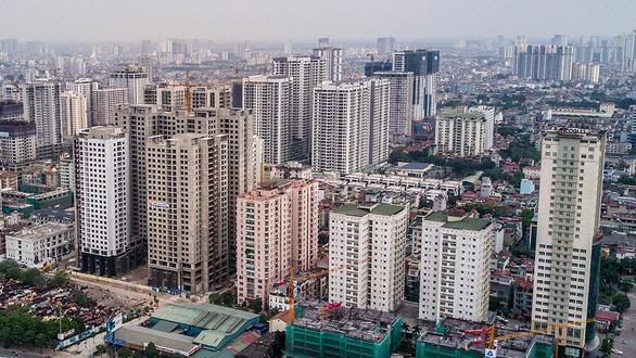 Bất động sản Hà Nội, TP.HCM: Nguồn cung giảm, giá bán tăng - Ảnh 2.
