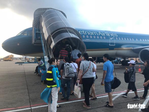 Hành khách nối chuyến bay được hỗ trợ nhanh thủ tục - Ảnh 1.