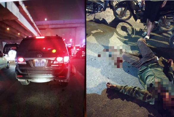 Xác minh xe biển xanh bỏ chạy sau khi tông người chạy xe ôm bất tỉnh - Ảnh 2.