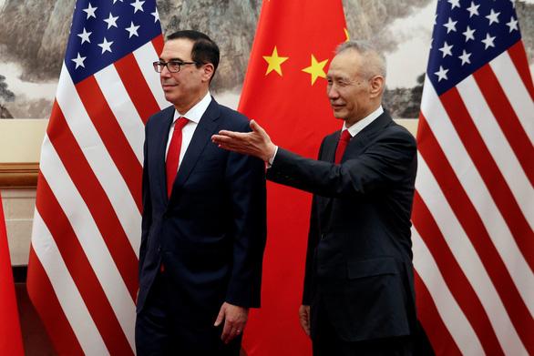 Trung Quốc phản ứng: Không nên đàm phán khi bị gí súng vào đầu - Ảnh 1.