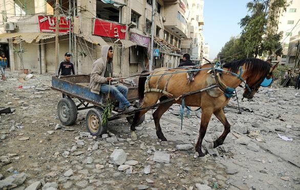 Đấu pháo kinh hoàng ở Dải Gaza - Ảnh 1.