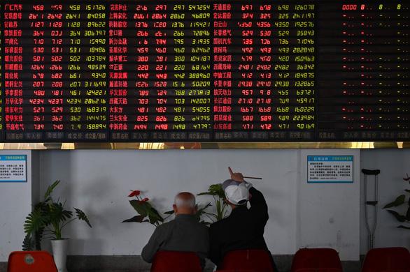 Chứng khoán châu Á tràn sắc đỏ khi căng thẳng thương mại Mỹ - Trung leo thang - Ảnh 2.
