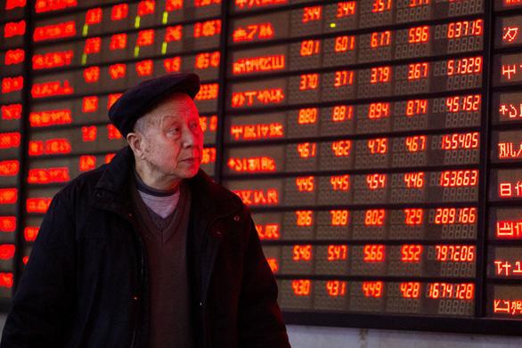 Chứng khoán châu Á tràn sắc đỏ khi căng thẳng thương mại Mỹ - Trung leo thang - Ảnh 1.