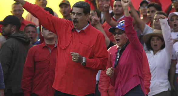 Venezuela tuyên bố không cần xài đôla Mỹ nữa - Ảnh 1.