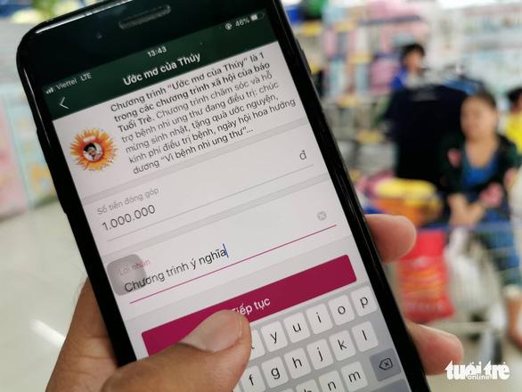 Mời bạn đọc Chung tay cùng Tuổi Trẻ trên ví điện tử MoMo - Ảnh 1.
