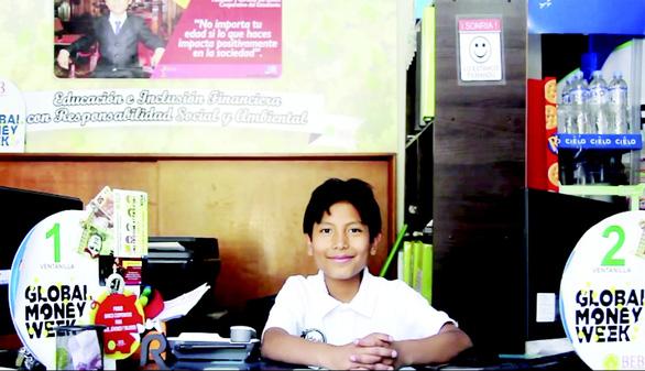 Ông chủ ngân hàng 14 tuổi - Ảnh 1.
