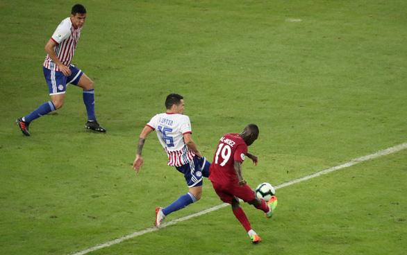 Qatar cầm hòa Paraguay sau khi bị dẫn trước 2 bàn - Ảnh 1.