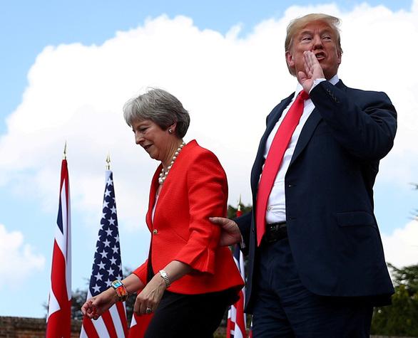 Ông Trump kêu gọi Anh cực kỳ thận trọng về Huawei - Ảnh 1.