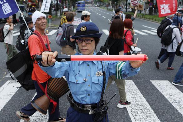 Hội nghị G20: 32.000 cảnh sát bảo vệ 30.000 quan khách - Ảnh 1.
