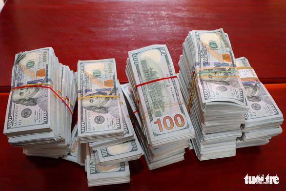 Sẽ tịch thu 470.000 USD nếu không ai đến nhận - Ảnh 1.
