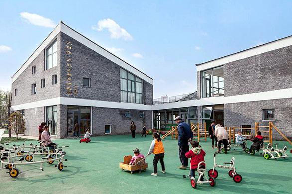 Trường mẫu giáo có kiến trúc như ngôi làng thu nhỏ ở Trung Quốc - Ảnh 3.
