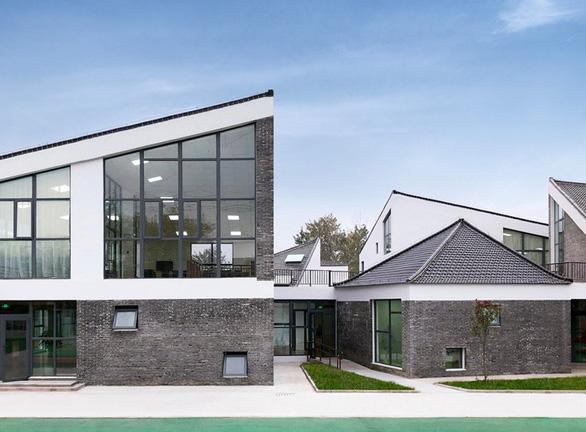 Trường mẫu giáo có kiến trúc như ngôi làng thu nhỏ ở Trung Quốc - Ảnh 6.