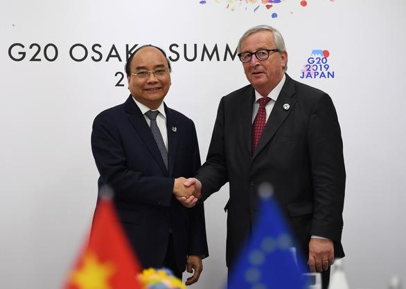 Thủ tướng Nguyễn Xuân Phúc chụp ảnh cùng lãnh đạo các nước G20 - Ảnh 7.