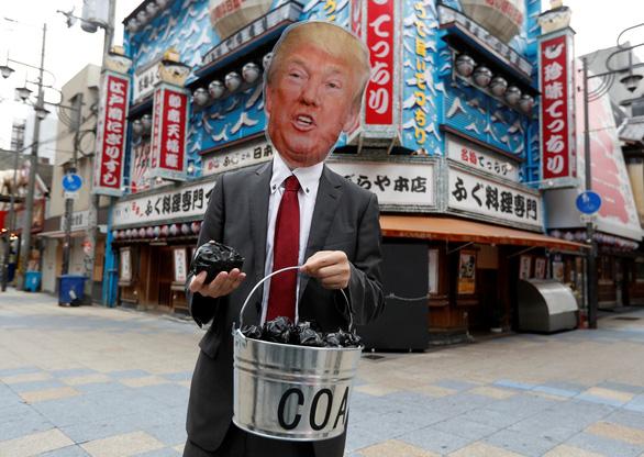 Các nhà lãnh đạo G20 xuống đường biểu tình ở Osaka - Ảnh 6.
