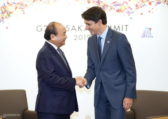 Thủ tướng Nguyễn Xuân Phúc chụp ảnh cùng lãnh đạo các nước G20 - Ảnh 5.