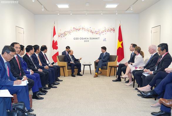 Thủ tướng Nguyễn Xuân Phúc chụp ảnh cùng lãnh đạo các nước G20 - Ảnh 6.