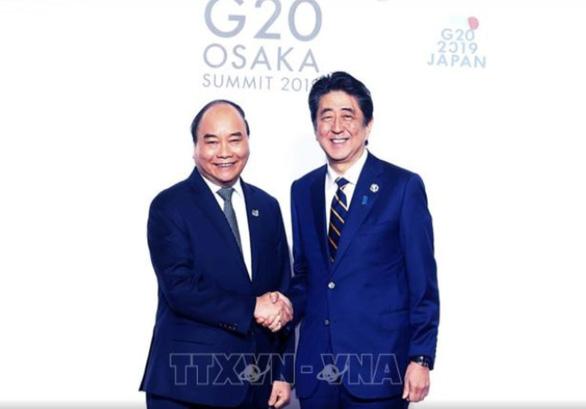 Thủ tướng Nguyễn Xuân Phúc bắt đầu dự Hội nghị Cấp cao G20 - Ảnh 1.