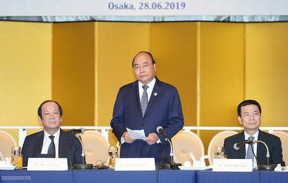 Thủ tướng Nguyễn Xuân Phúc bắt đầu dự Hội nghị Cấp cao G20 - Ảnh 4.