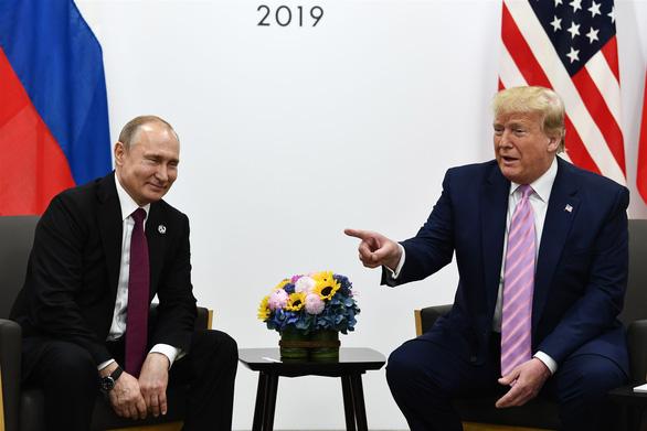 Ông Trump nói 'làm ơn đừng can thiệp bầu cử', ông Putin bật cười thích thú - Ảnh 2.